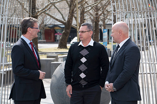 ACT Minister for Veterans Affairs Mr Gordon Ramsay speaking to ACT Public service staff members Ian Hildred, Senior manager Public sector standards unit, and Craig Rose, Deputy Director People Management, in front of the ACT Memorial
